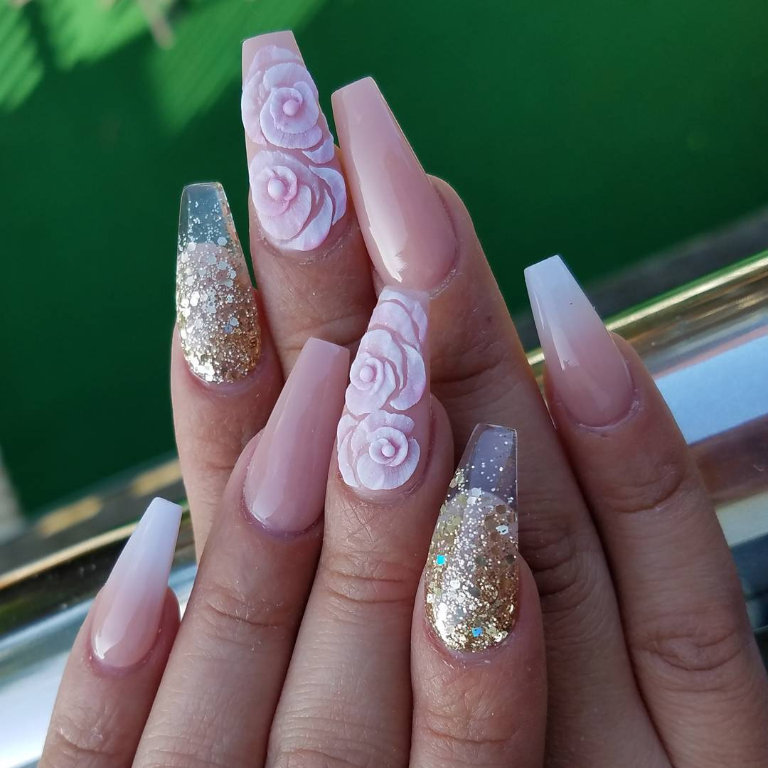 White floral gel nails with nude and glitter