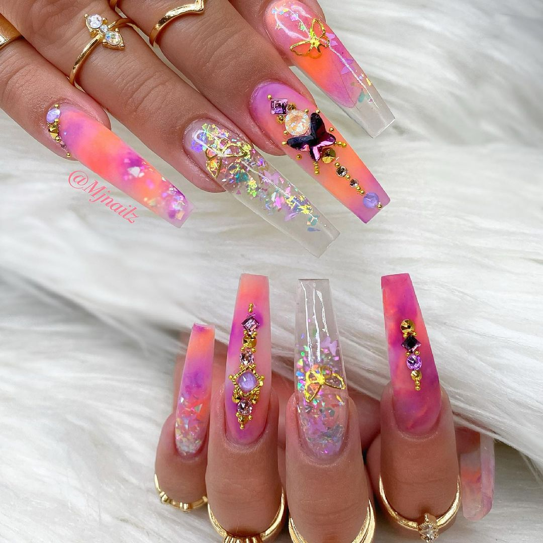 Pink and orange watercolor glitter nails with rhinestones