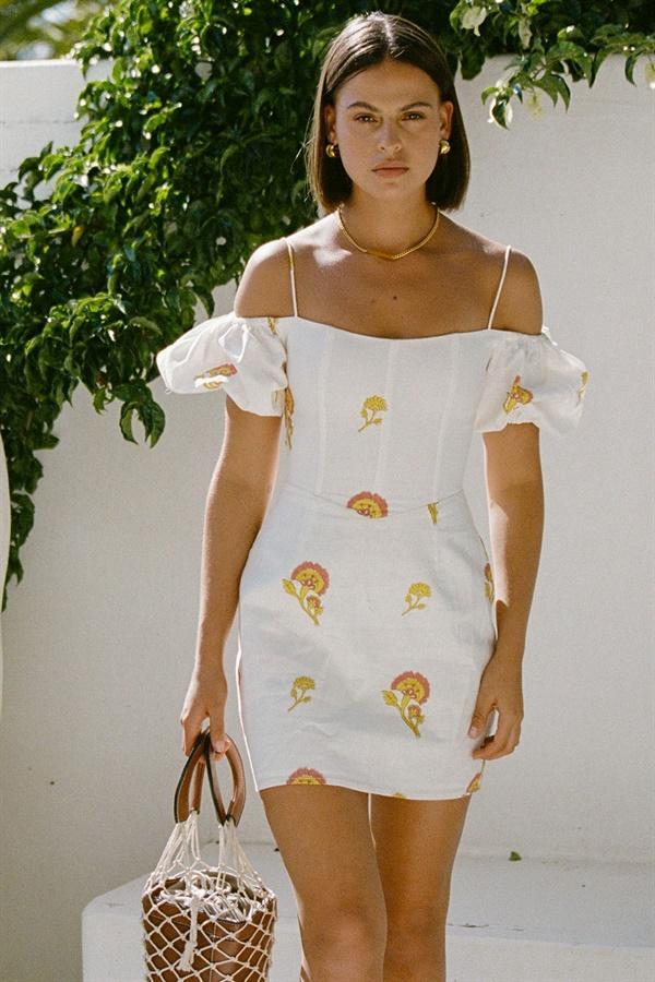 White off-shoulder dress with floral prints