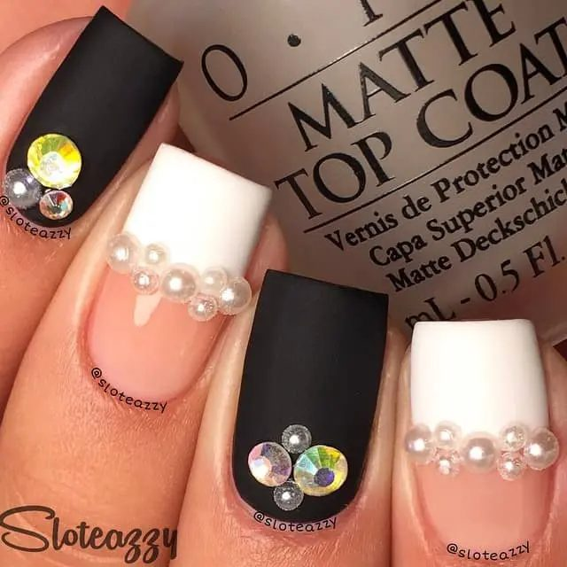 Matte black and white nails with rhinestones and pearls