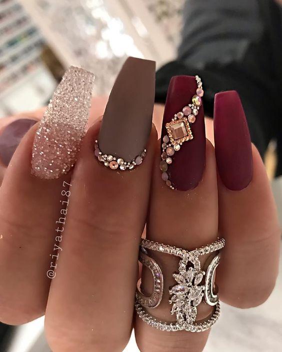 burgundy nails with grey and glitter design, rhinestones
