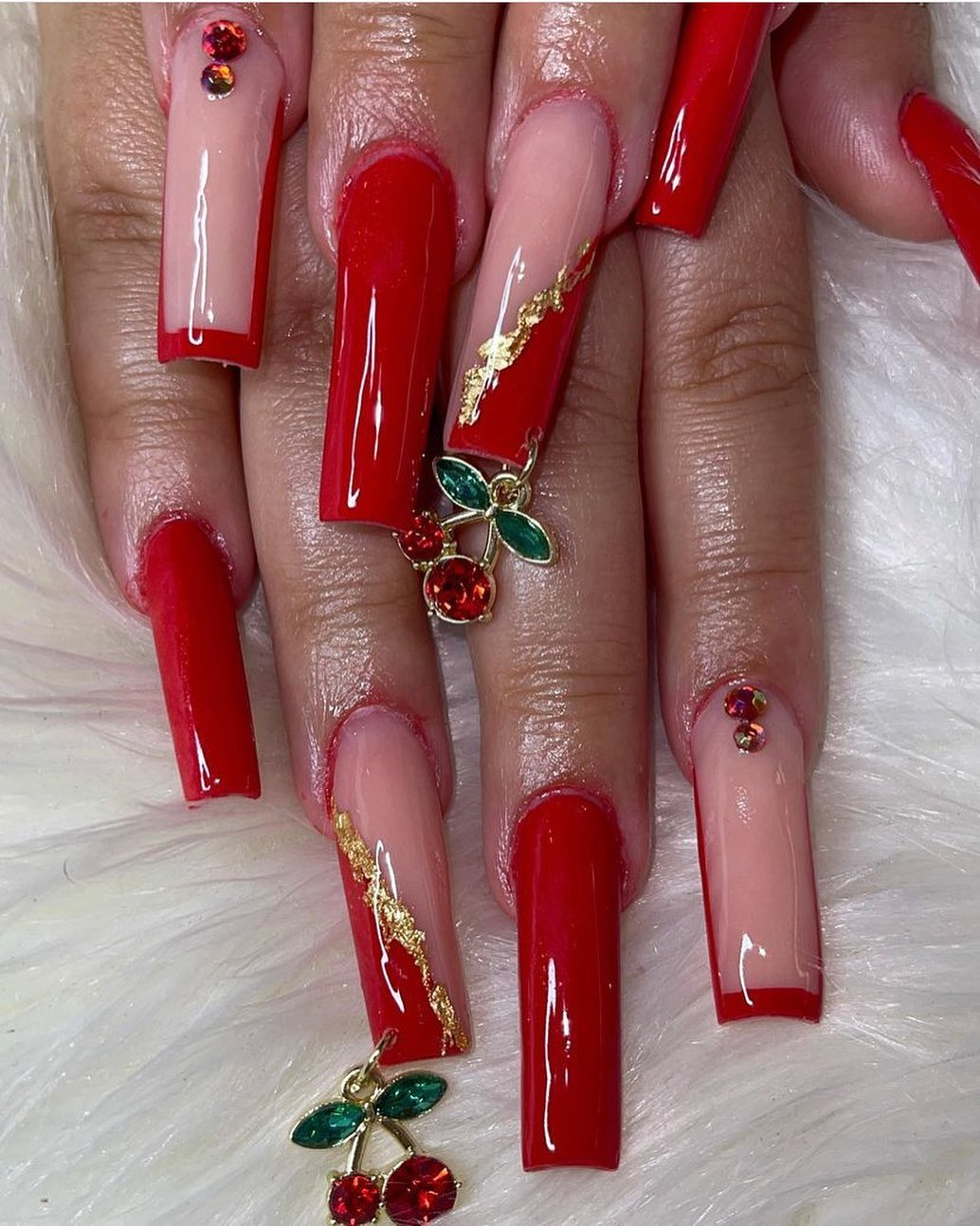 Cherry red nails with rhinestones and cherry decals