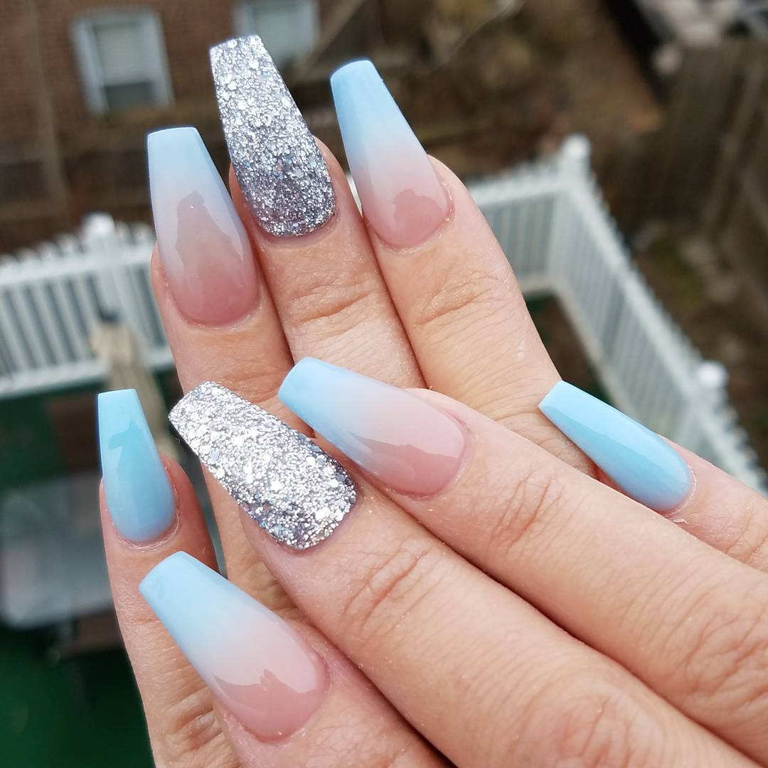 Dusty pink and blue ombre gel nails with glitter