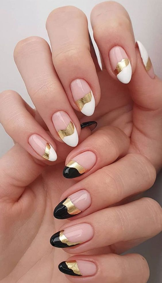 Black and white tipped nails with gold design
