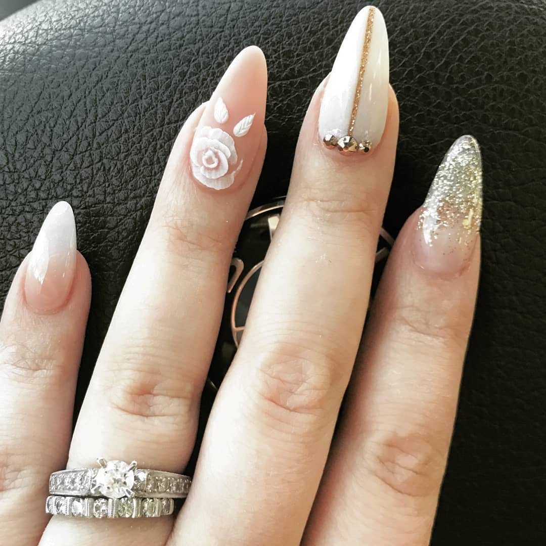 Nude gel nails with glitter