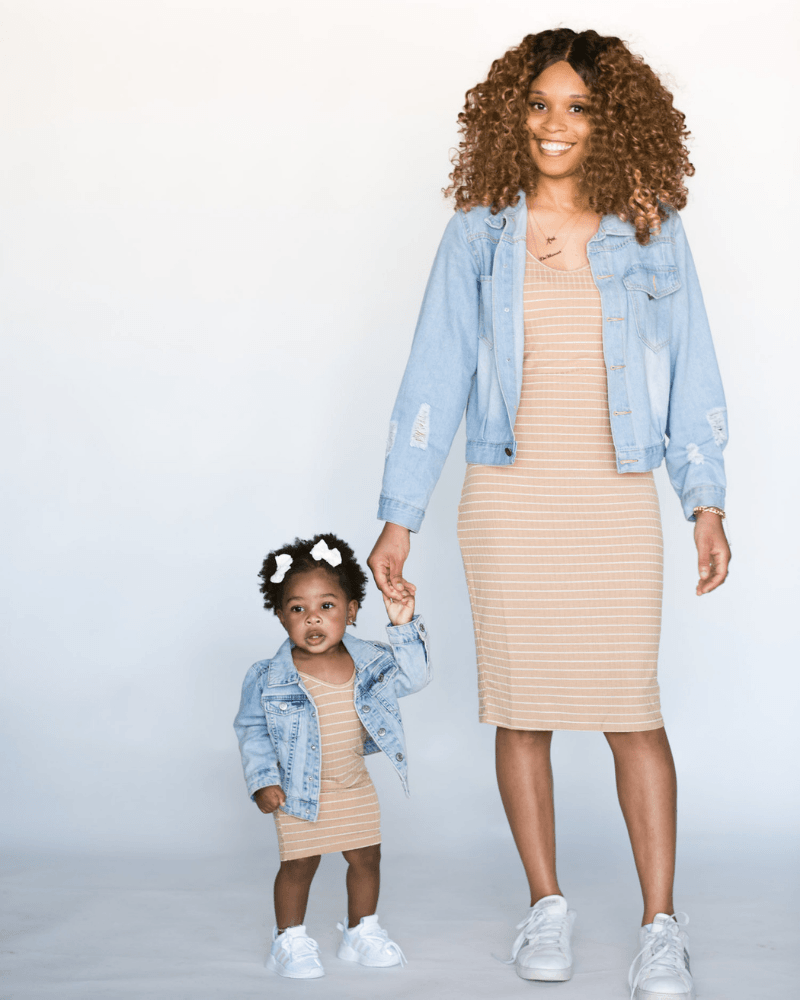 Matching striped bodycon dress and denim jacket outfit for mom and daughter