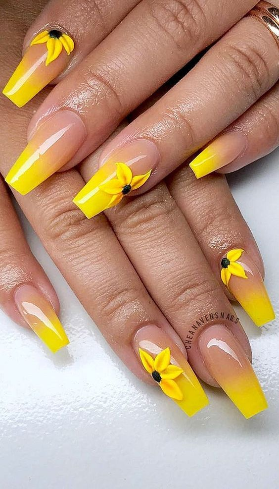Nude and yellow ombre nails with 3D sunflowers