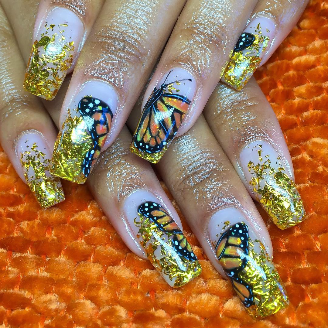 Butterfly nails with gold flakes