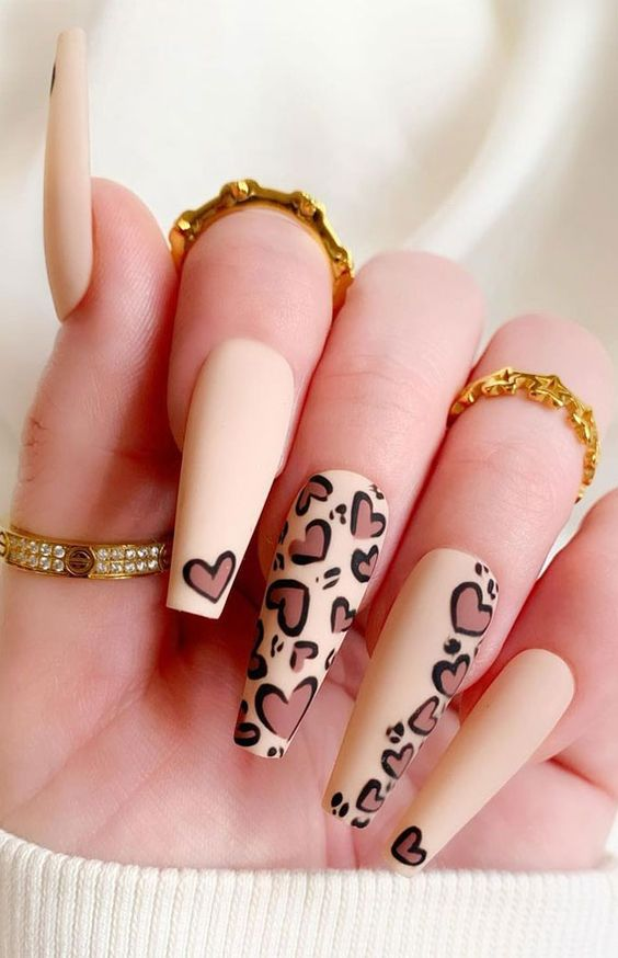 Nude heart leopard nails