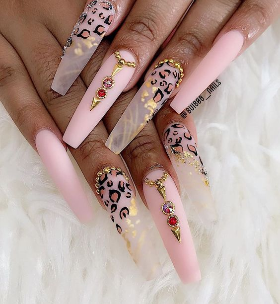 Soft pink matte and clear leopard nails with rhinestones