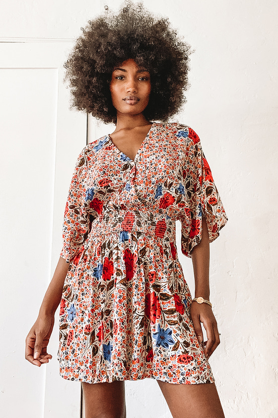 Patterned flowy mini dress for gender reveal outfit