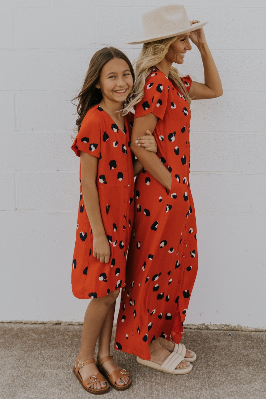 Matching orange dress with dots for mom and daughter