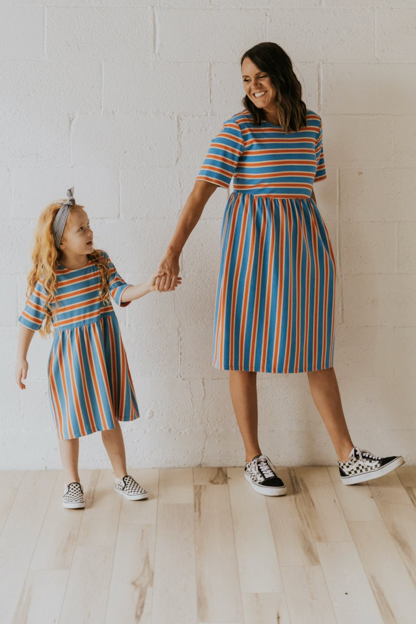 Matching blue and orange striped dress for mom and daughter