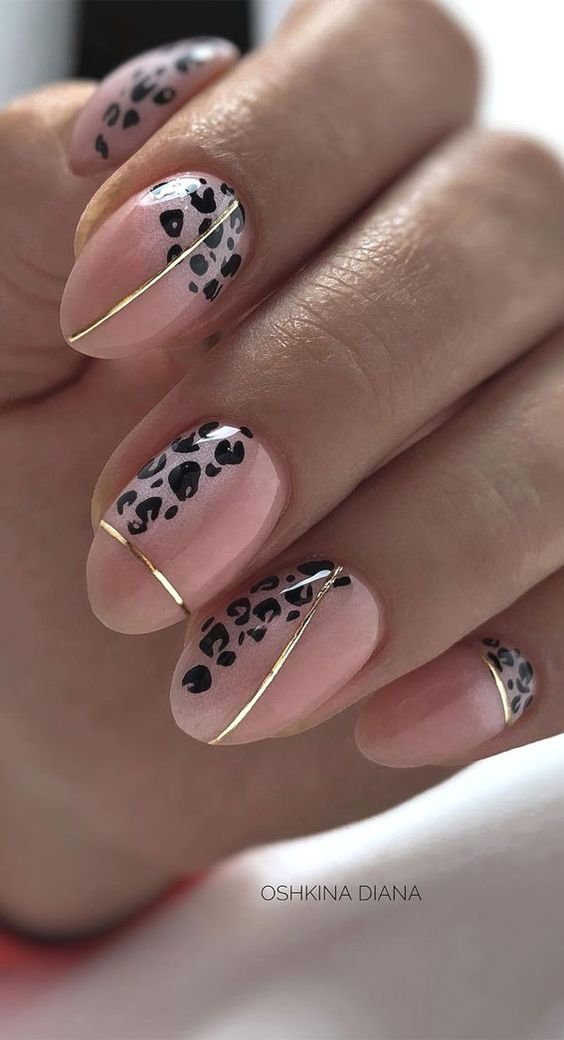 Beige leopard nails with gold decals