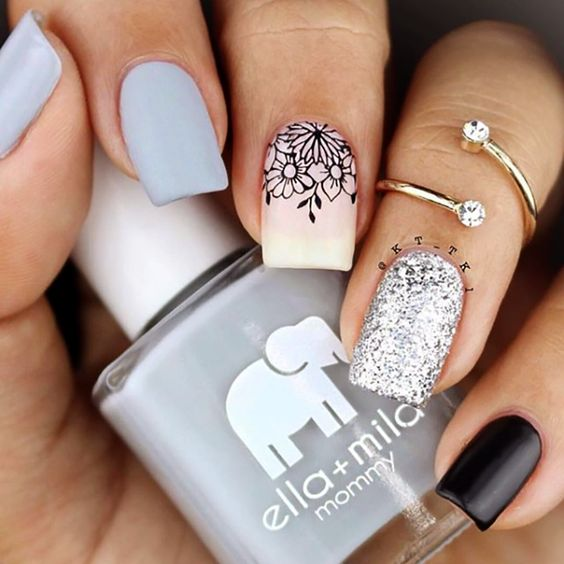 Light grey and nude nails with glitter and floral design