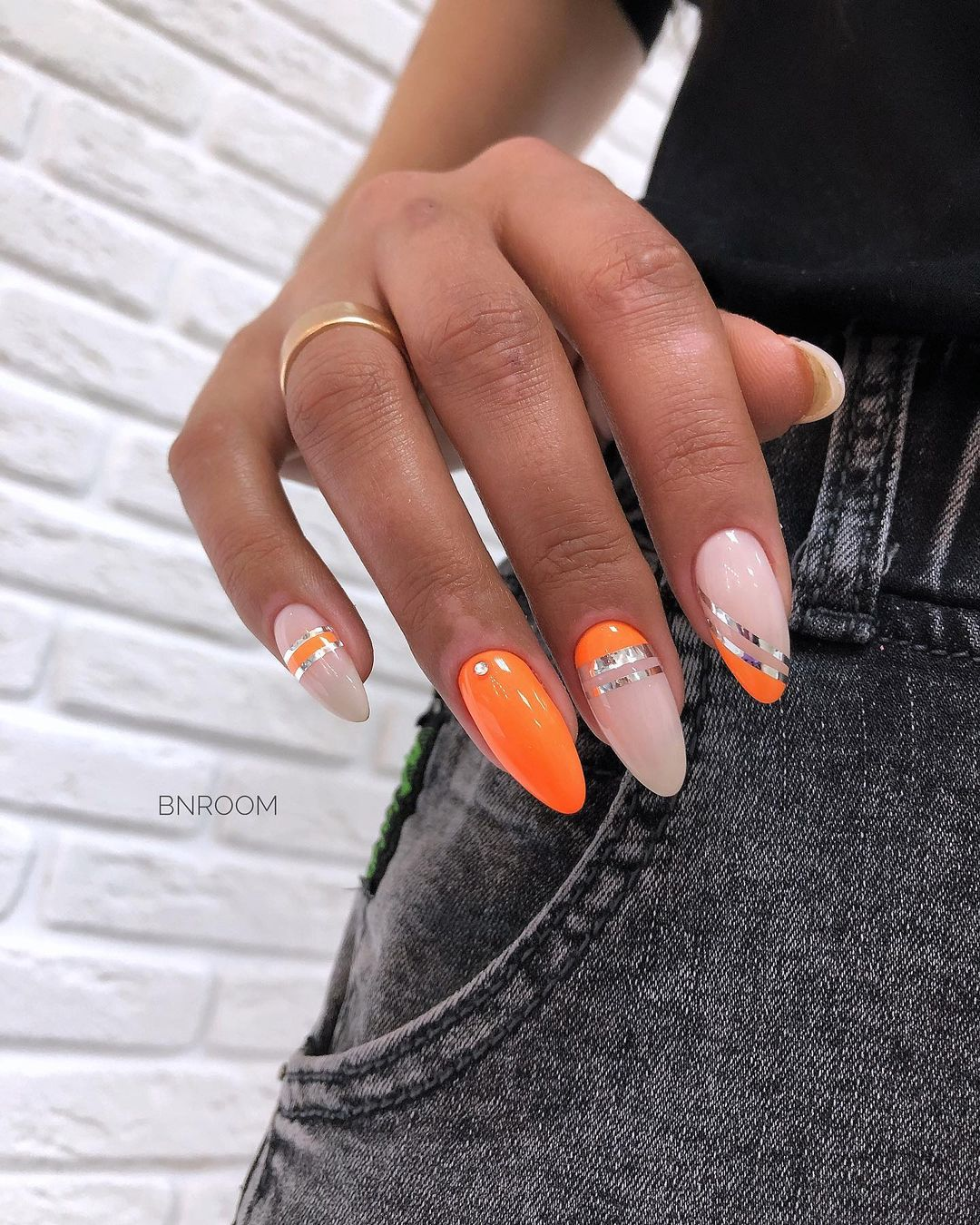 Orange and nude gel nails with silver details