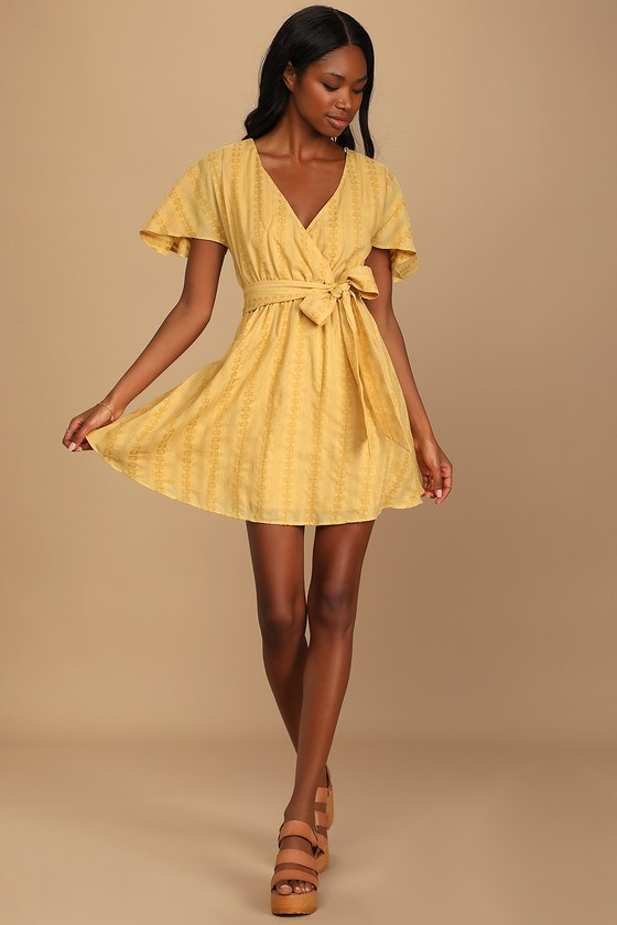 Mustard yellow mini wrap dress for gender reveal outfit