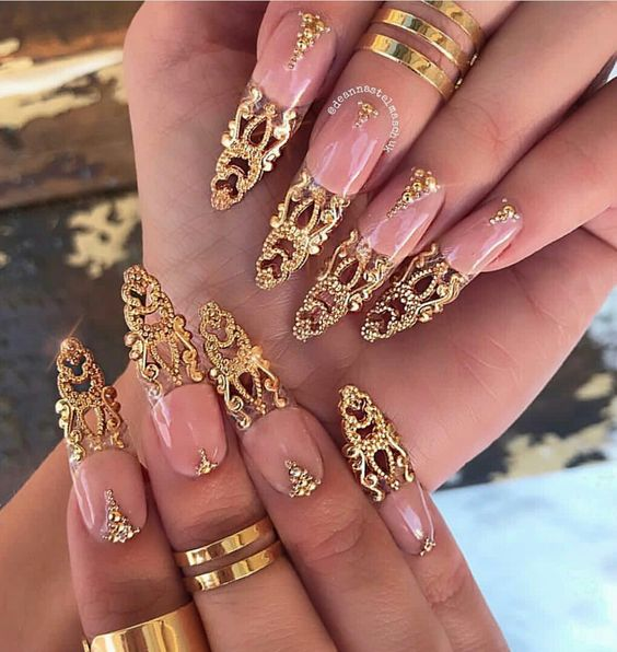 Nude nails with extravagant gold tips