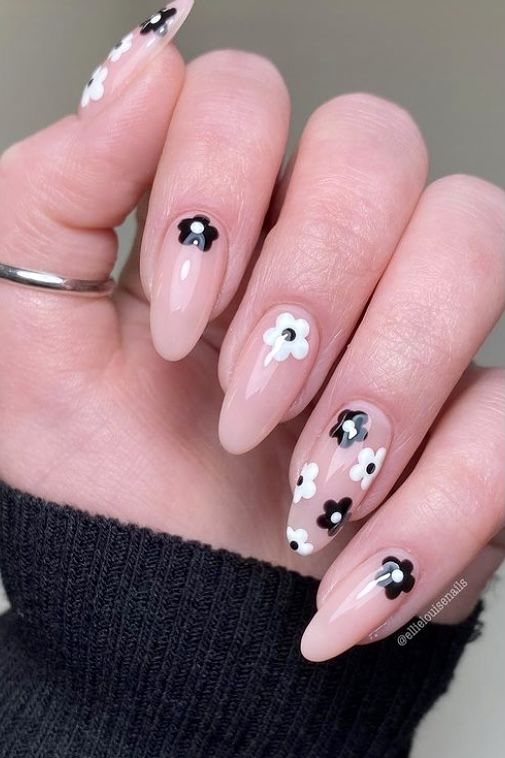 Nude nails with black and white flowers