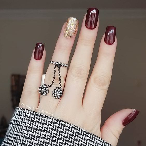 Burgundy nails with gold glitter