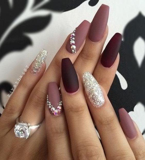 Matte burgundy nails with mauve and glitter white rhinestones
