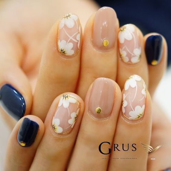 Nude floral gel nails with navy blue