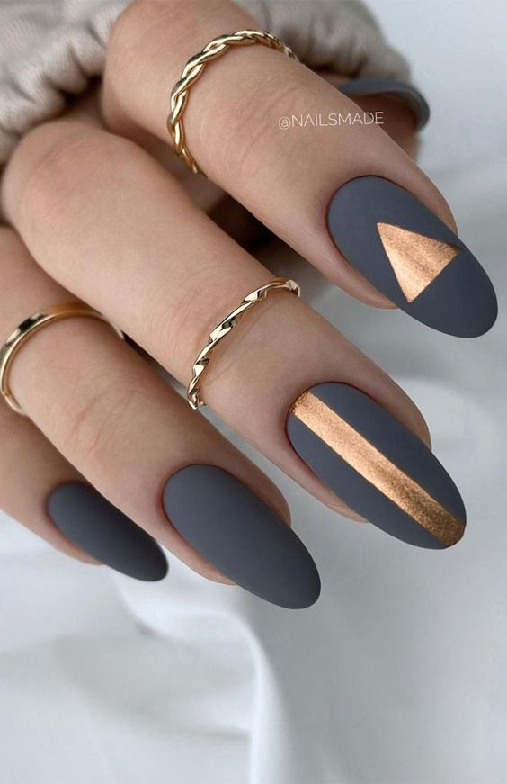 Matte grey nails with gold designs