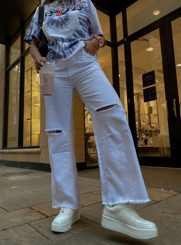White flared pants