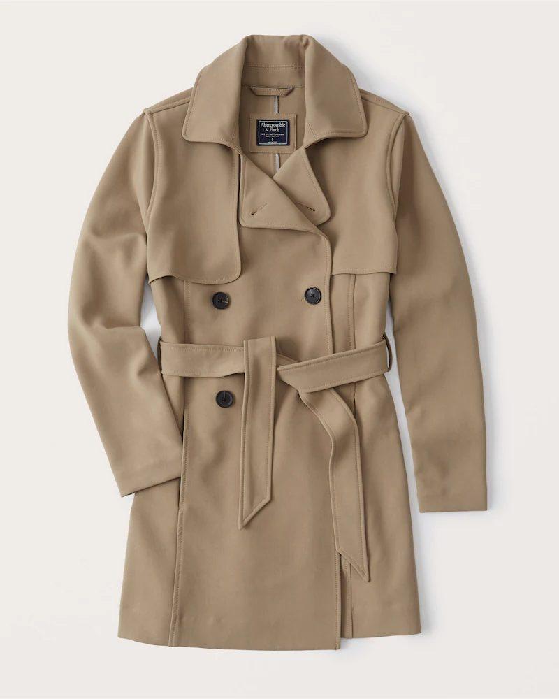 Beige trench coat for minimalist french capsule wardrobe