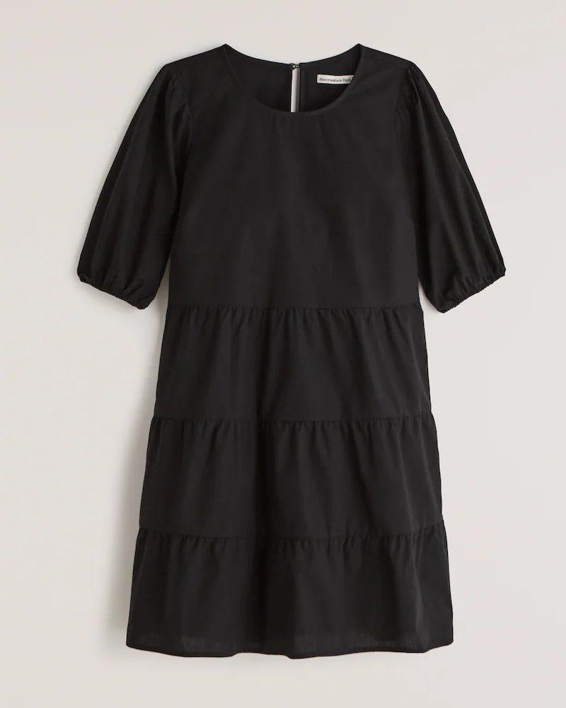 Basic black dress for minimalist french capsule wardrobe