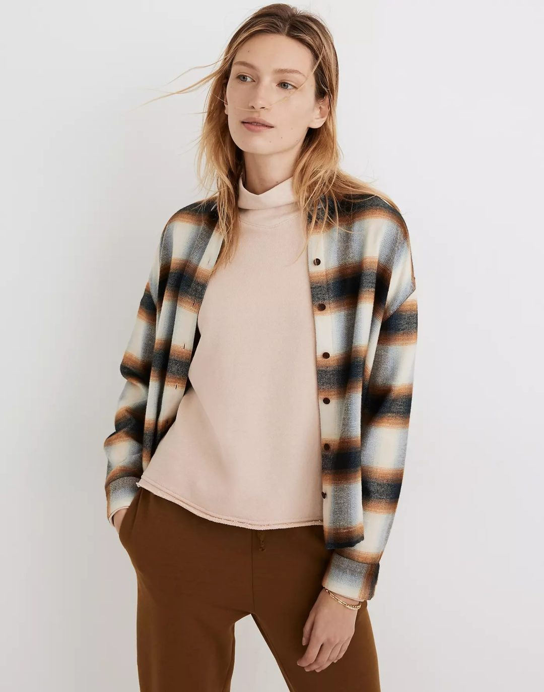 Plaid cardigan with brown pants