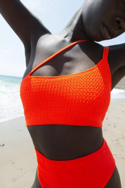 Orange asymmetrical bikini from Urban Outfitters from Broad Shoulders