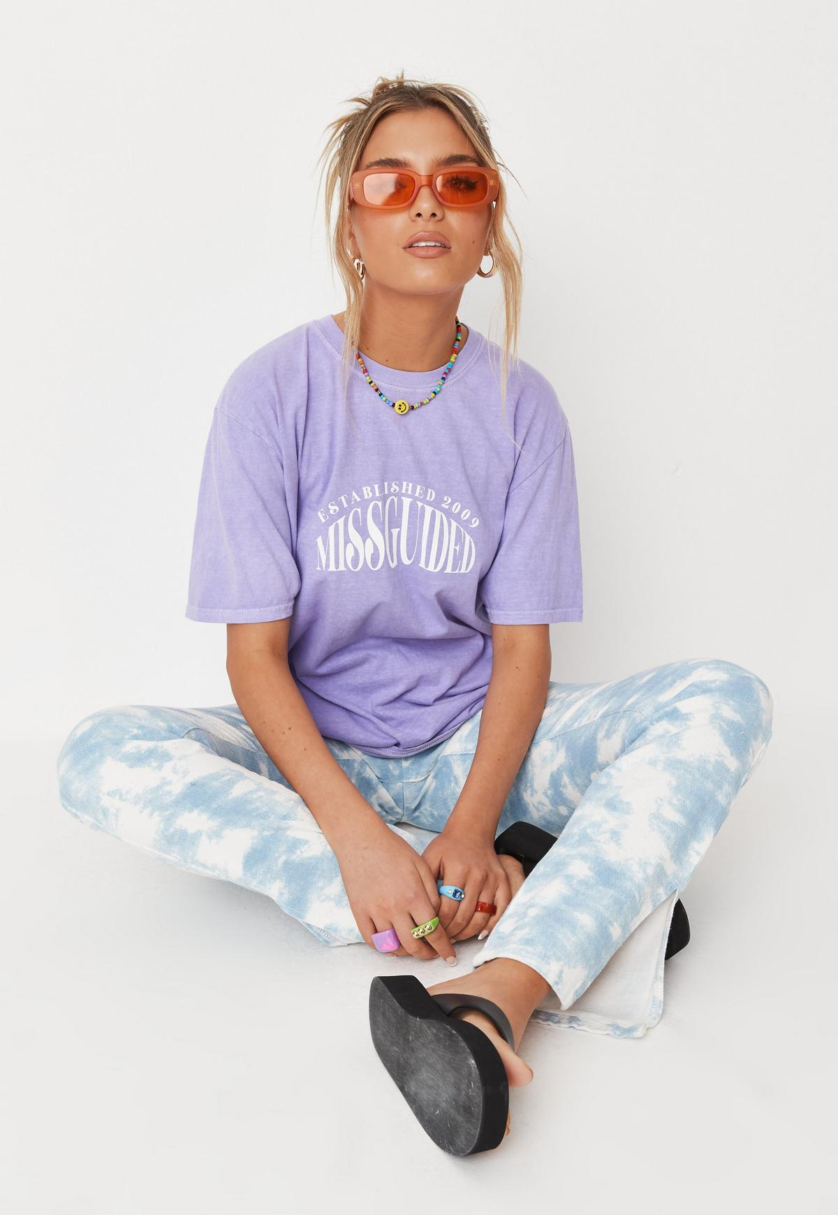 Cute 90s inspired outfit with purple t-shirt and tie dye leggings