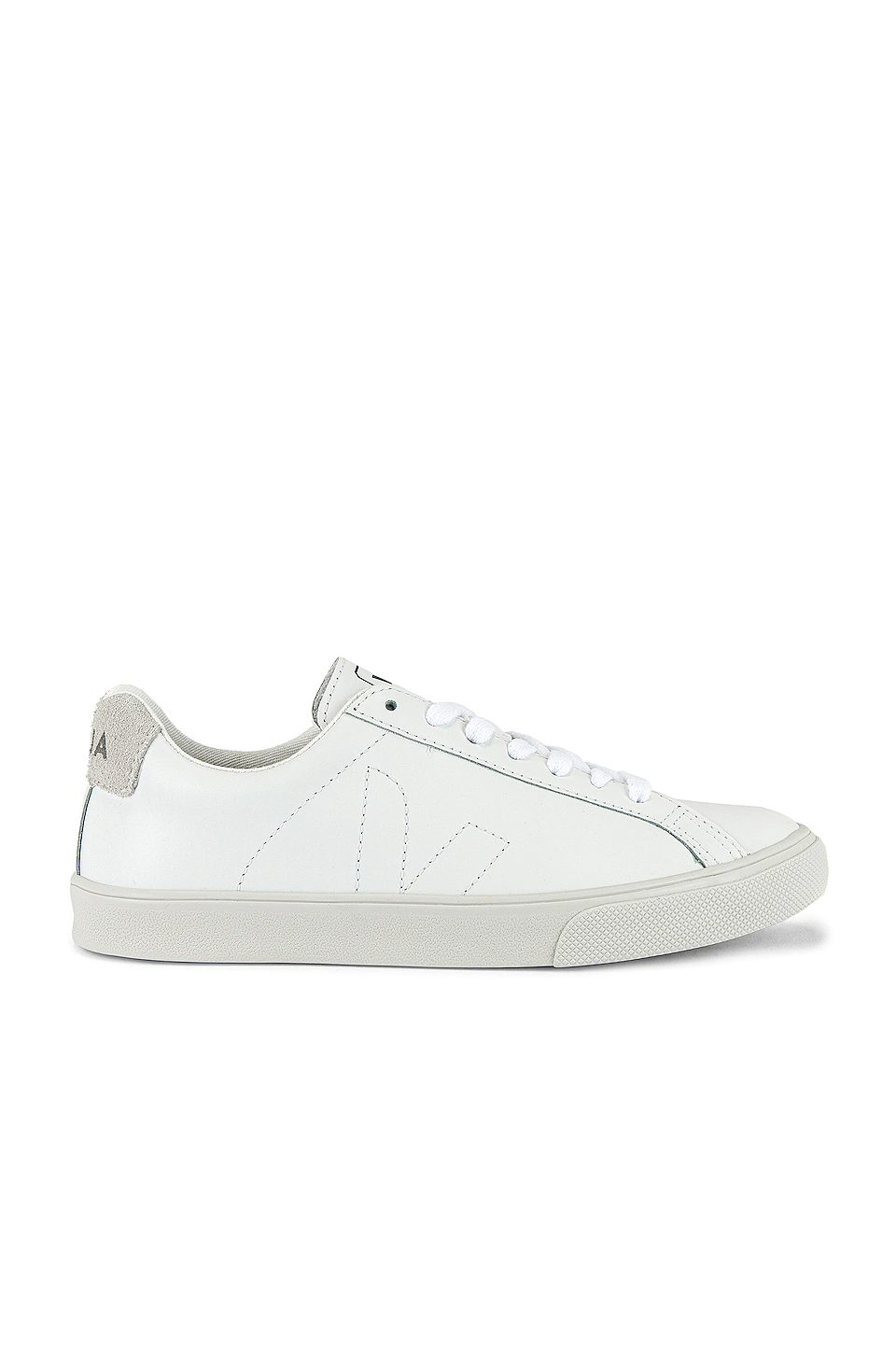 Classic white sneakers for minimalist french capsule wardrobe