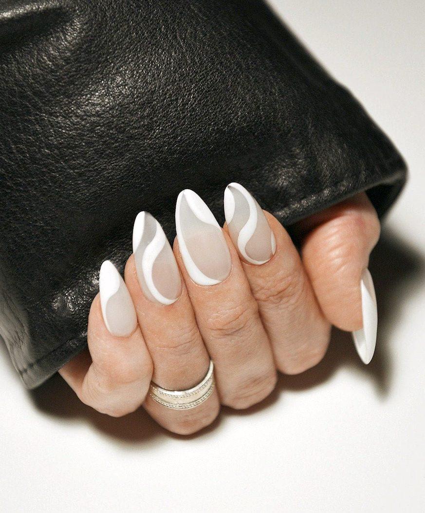 White wavy nails with swirls