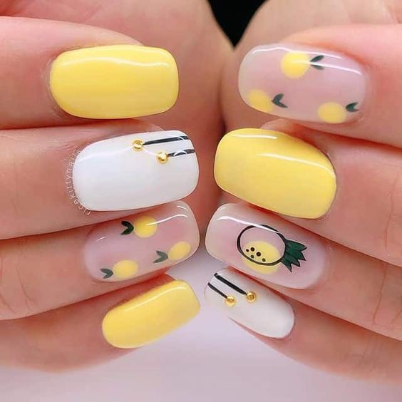 Soft yellow nails with rhine and lemon design