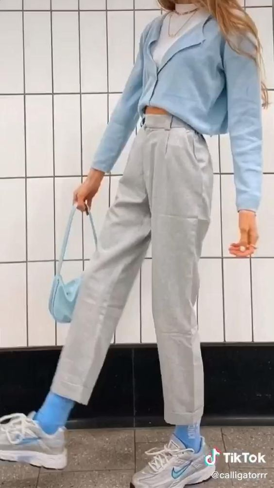 Blue top and tailored pants