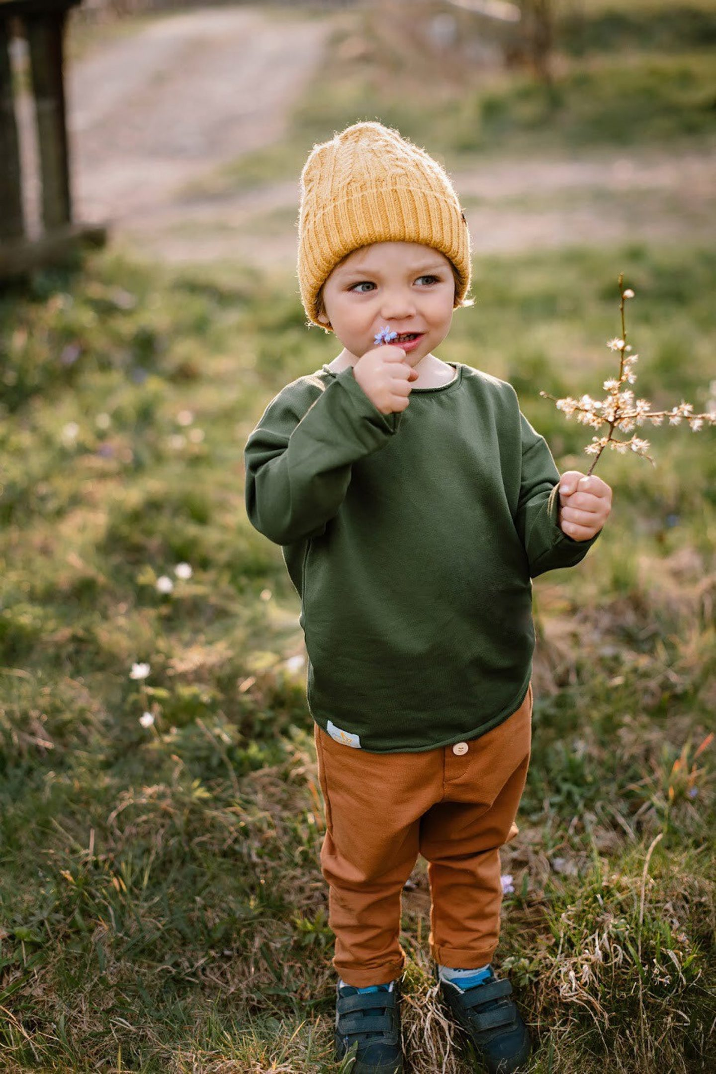 Cute Earth tones baby boy outfit idea with yellow hat
