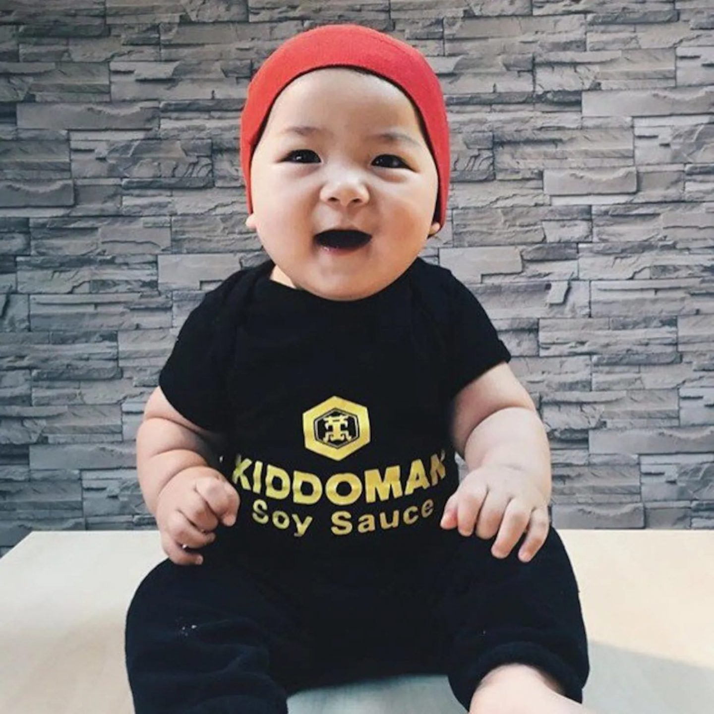 Cute and funny baby Halloween costume with soy sauce