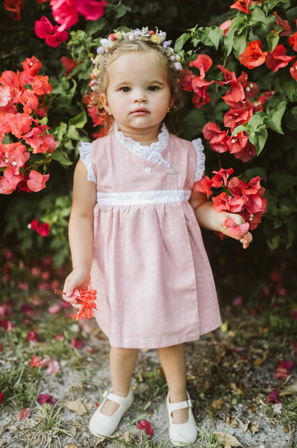 Pink dress for toddlers with white lace trim