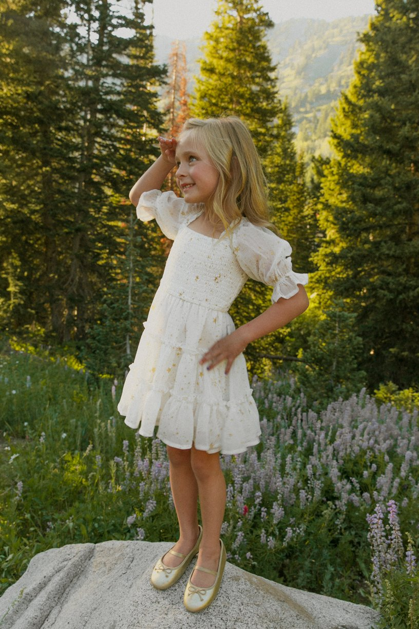 White smock dress with stars for baby girls