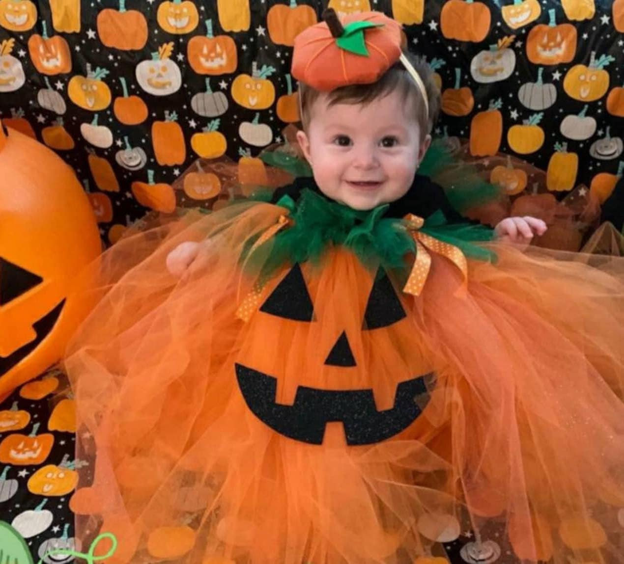 Cute baby pumpkin Halloween costume with orange tulle skirt