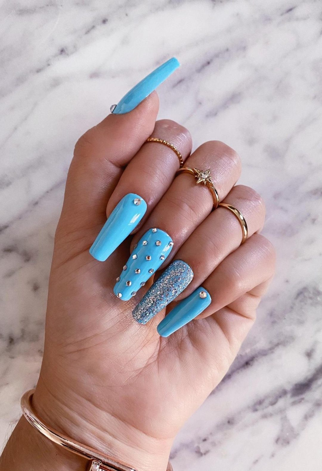Baby blue nails with rhinestones and glitter
