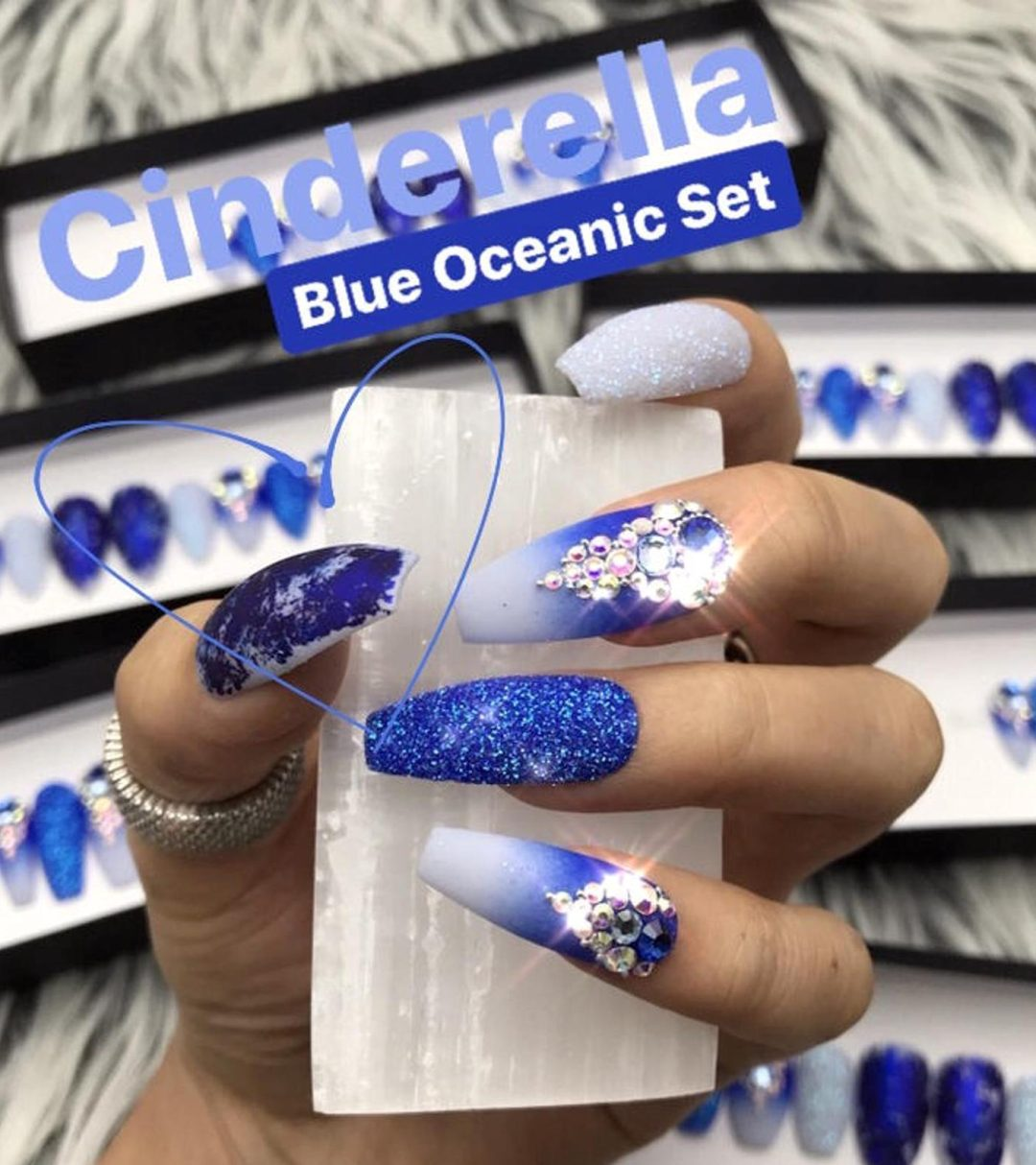 White and dark blue ombre nails with glitter and rhinestones
