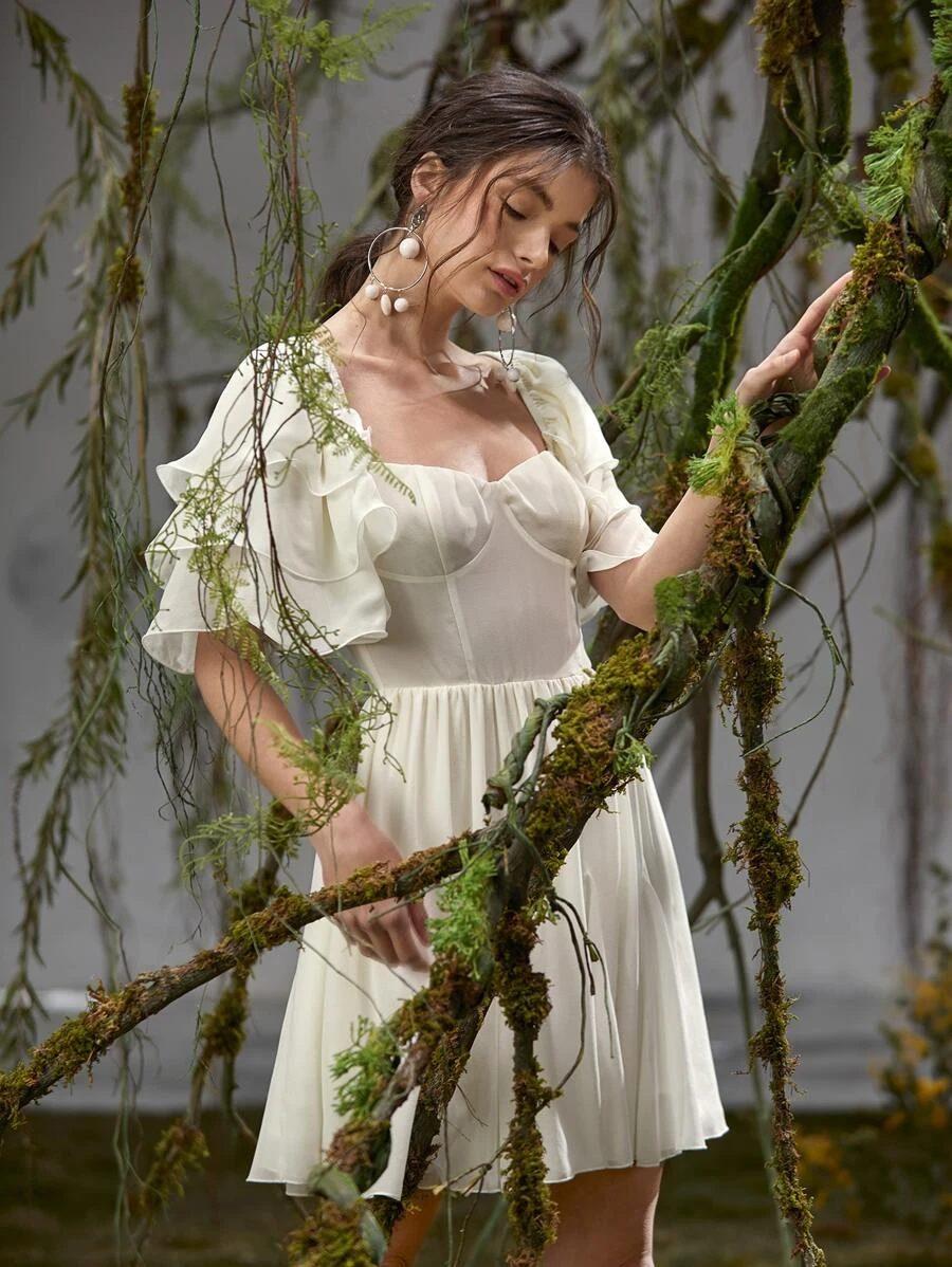 White bustier dress in dark academia aesthetic