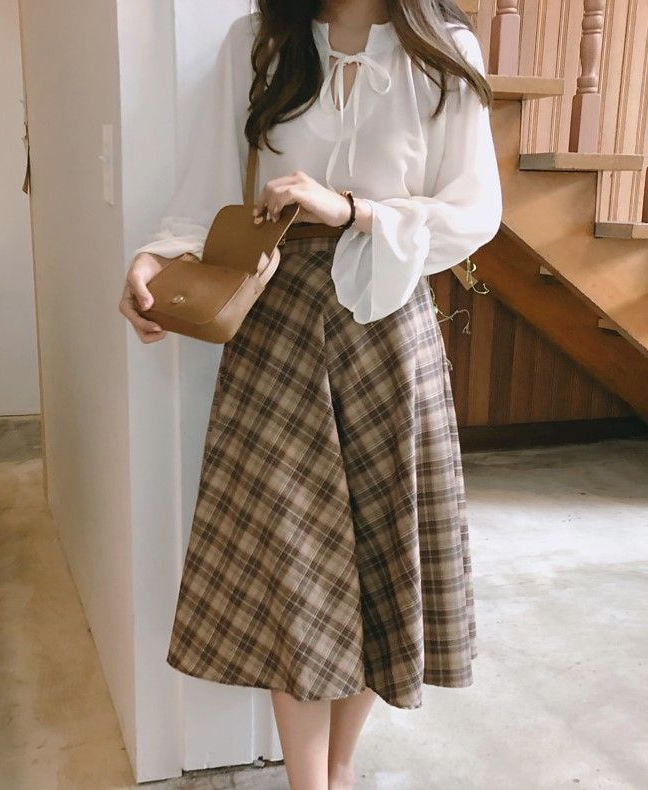 Dark academia outfit with plaid midi skirt and white blouse