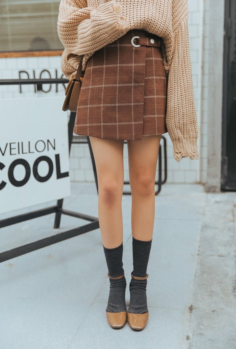 Cute dark academia outfit with brown plaid skirt and sweater