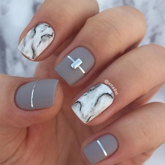 Matte grey nails and white marble design