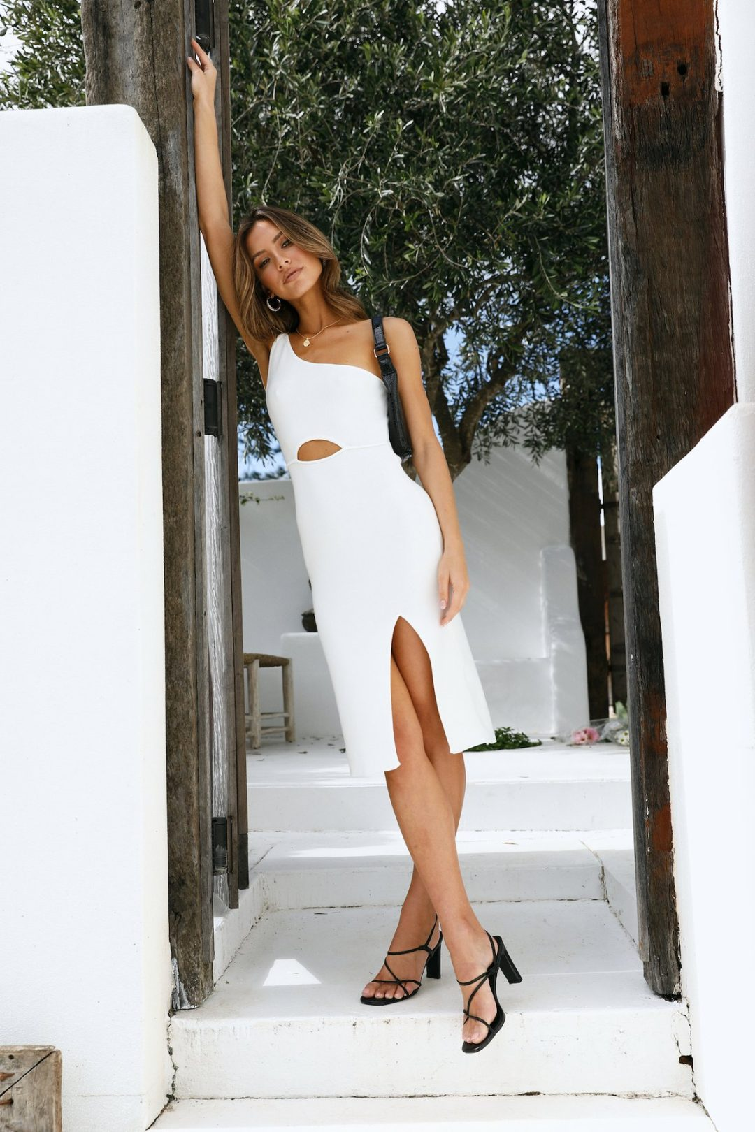 White midi dress with thigh slit and cutout details