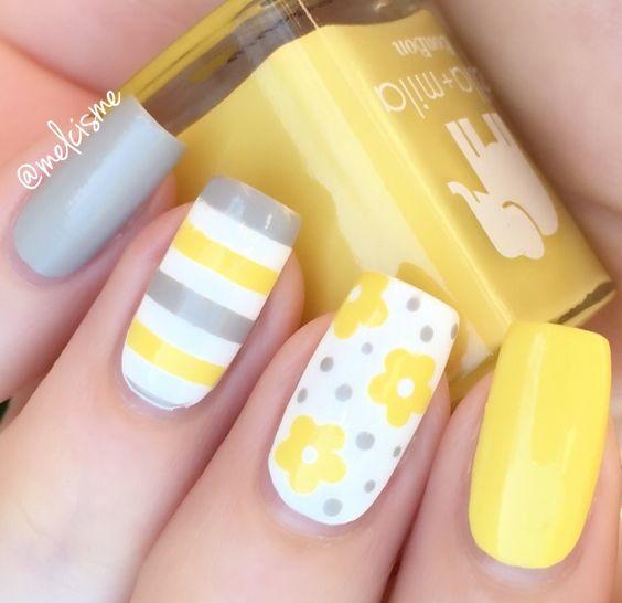 Yellow and grey nail design